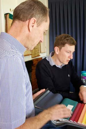 Densi and Marcus discussing curtain fabrics