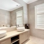 White custom plantation shutter fitted to a bathroom window