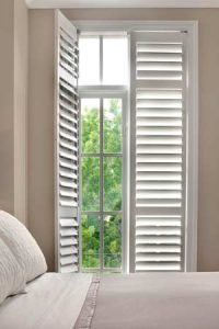 White plantation shutters fitted to french windows