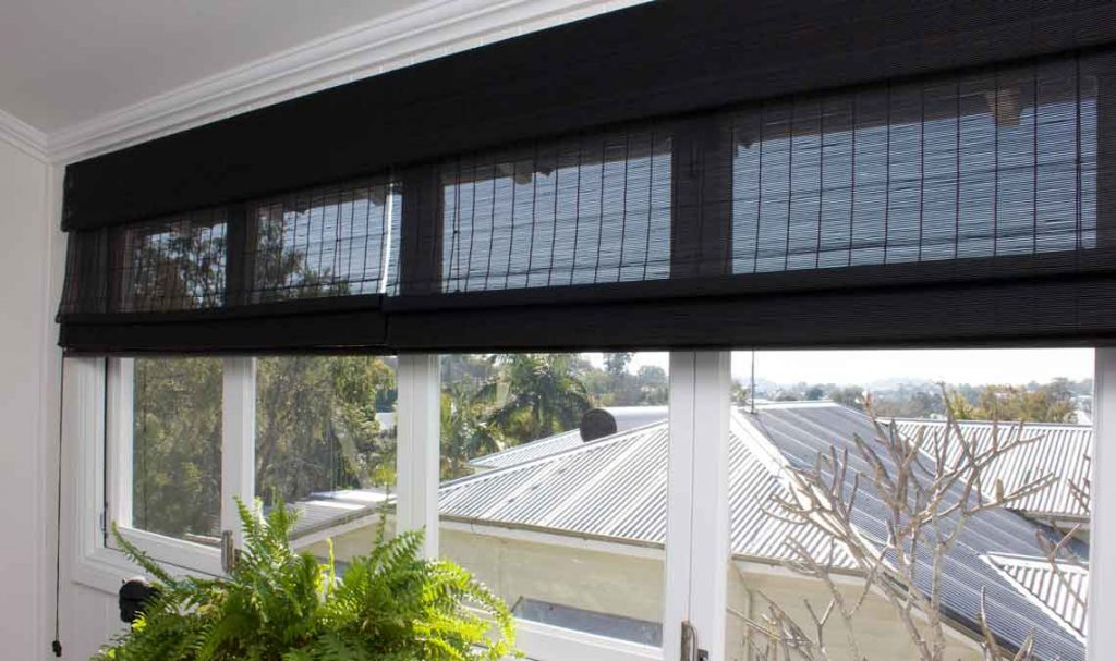 Black matchstick Roman style window blind in a period home