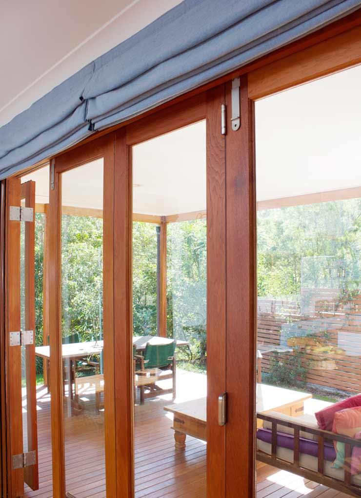 Custom Roman blinds fitted neatly above bi-fold doors