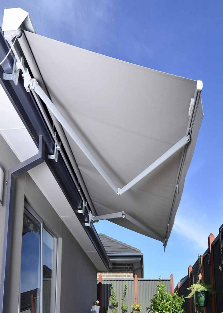 Photo of Folding Arm Awning shading a window