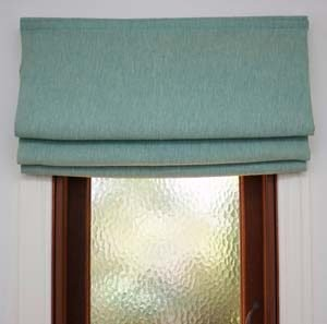 Turquoise Roman Blind softens a small window