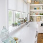 Simple white roller blind in a kitchen