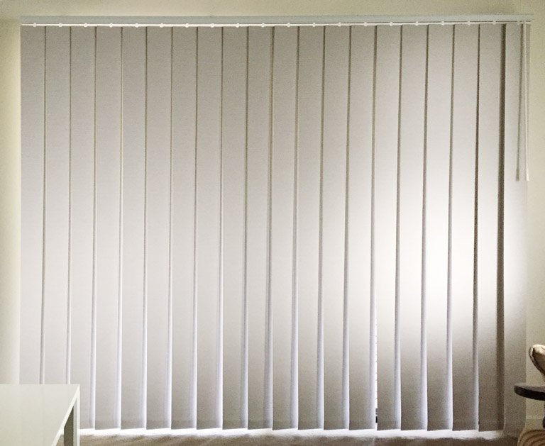 Vertical blinds for a sliding glass door