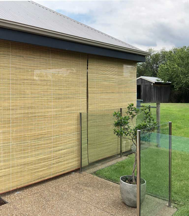 Outdoor bamboo blind fitted to an entertainment area